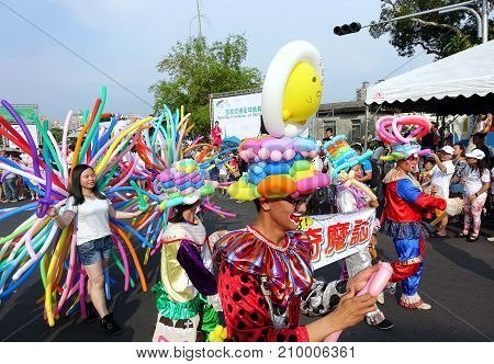 Balloon Artists Join A Street Parade