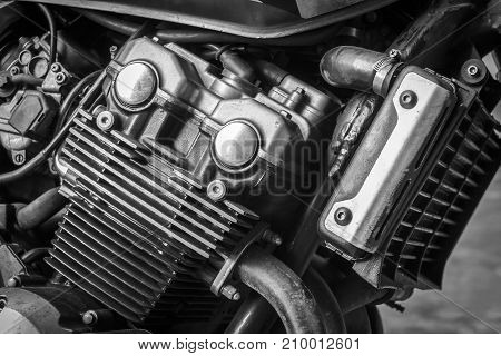 Detail of motorcycle engine for transportation or technology concept design.