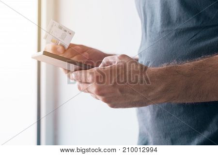 Man registering new GSM sim card on his personal mobile phone device