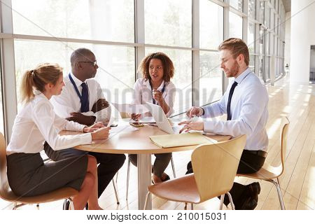 Four business colleagues in a team meeting