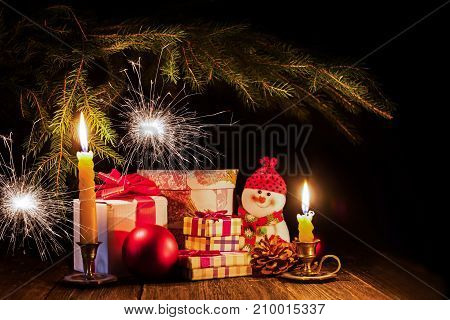 New Year. Decorations and gifts. Spruce branches and Bengal lights. Symbols of the holiday.