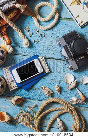 Camera, Phone And Maritime Decorations On The Wooden Background