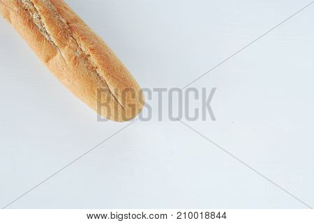 French Bread Baguette On A Table White Background