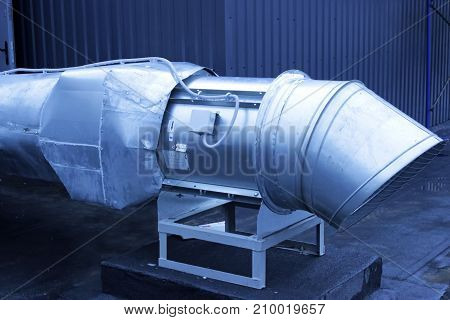 large galvanized pipe system for extracting air from the room