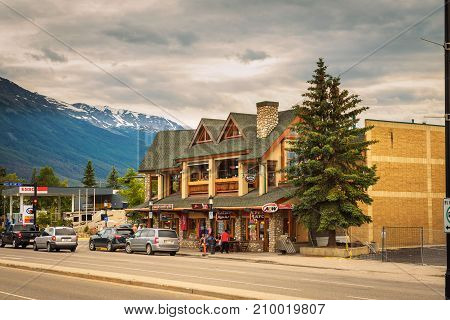 JASPER, ALBERTA, CANADA - JUNE 26, 2017 : Evening on the streets of Jasper in canadian Rocky Mountains. Jasper is located in the Athabasca River valley and is a popular tourist destination.