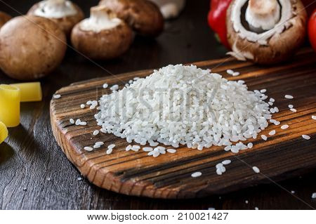 Bunch of rice on a wooden kitchen board