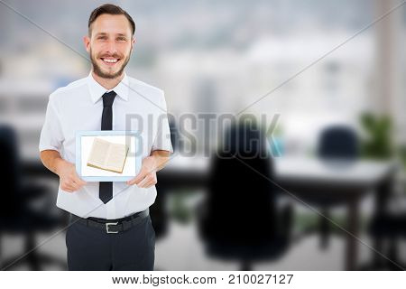 Geeky businessman showing his tablet pc against computer graphic image of empty board room
