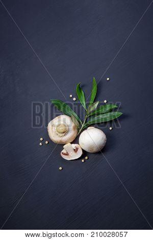 Mushrooms on black kitchen table