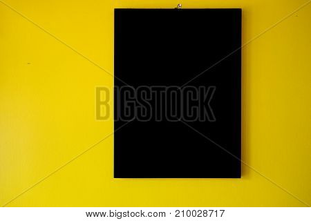 Beautiful blsck frame on a yellow background for decoration
