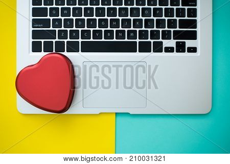 Red heart on the computer Internet dating Valentines day concept copyspace