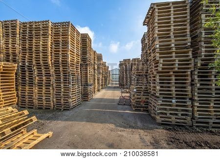 Business Area With Huge Piles Of Cargo Pallets