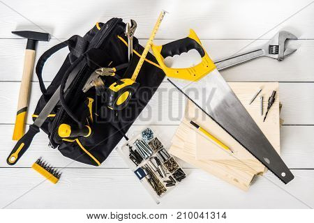 top view bag with repair tools on white background