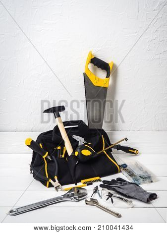 bag with repair tools on white background