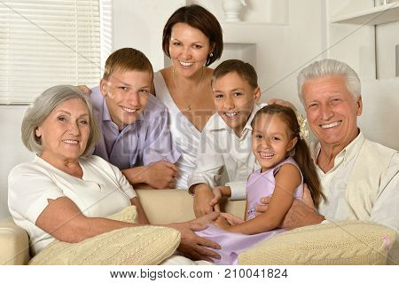 Portrait of big happy family sitting on couch