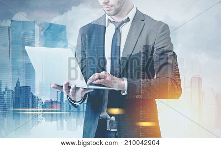 Bearded Businessman With A Laptop In A City