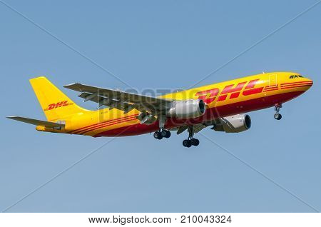 London UK April 9th 2011: an aircraft of international freight DHL in short final for landing at Heathrow.
