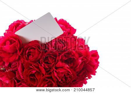 Bouquet of red roses in a wicker vase on a white background