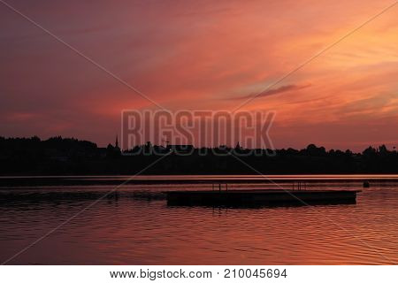 Romantic sky over lake Pfaeffikon Switzerland. Summer scene.