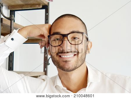 Handsome Smiling Latino Businessman Reading