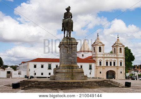 Statue Of King On Horse Facing Church And Monastery
