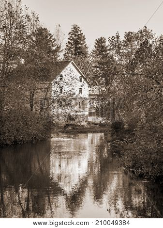A sepia toned photograph of the old Gristmill of Historic Walnford in Upper Freehold New Jersey.