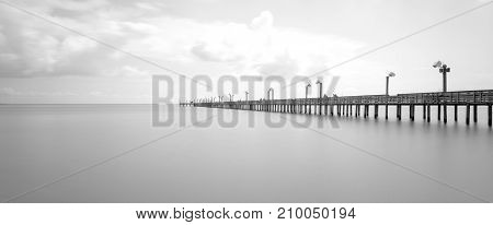 Wooden Fishing Pier In La Porter, Texas, Usa In Long Exposure, B