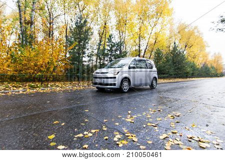 KHABAROVSK RUSSIA - OCTOBER 14 2017: Toyota Porte hatchback moving on autumn road