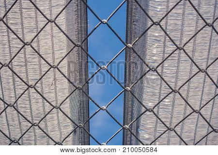 Abstract image close up burlap and metal net with blue sky background. (Soft focus)