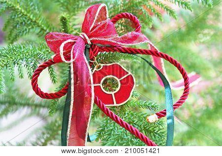 decorative Christmas lucky charm on green tree - Christmas home decor