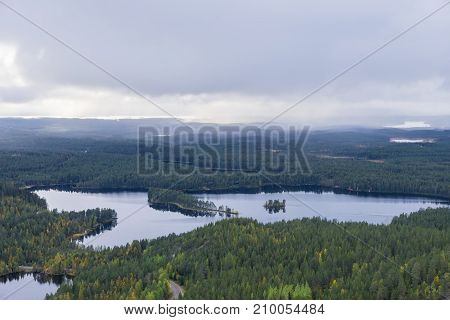 Mountains forests lakes view in autumn. Fall colors - ruska time in Konttainen. One part of Karhunkierros Trail. National park in Finland. Lapland Nordic countries in Europe