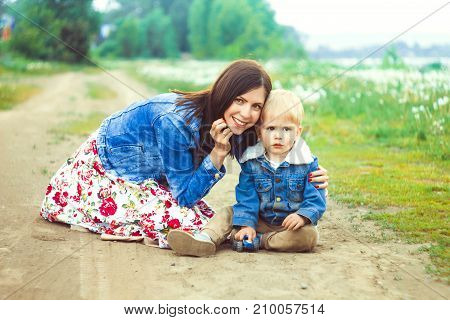 Mother and son share special moment on sand dunes of beach