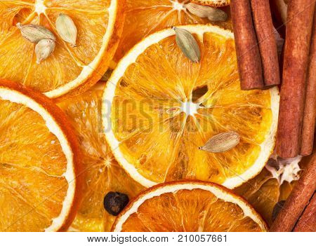 Dry slices of orange, cinnamon, allspice and cardamom