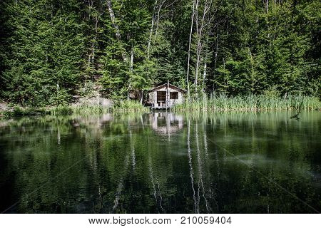 Old Wooden House By The Lake In The Forest