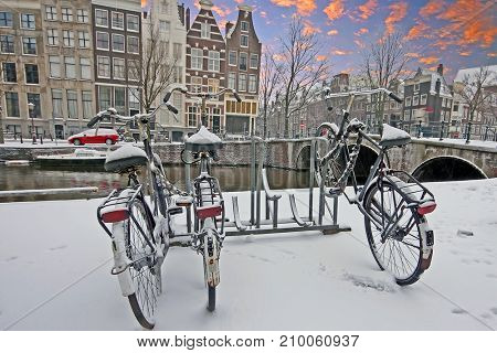 Sunset in snowy Amsterdam Netherlands in winter
