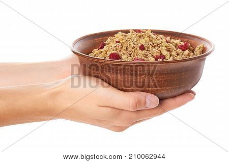Homemade Granola With Dried Fruits In Ceramic Jar In Hand Isolated On White Background