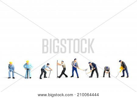 Miniature People Worker Holding Tool On White Bacckground, Construction Concept