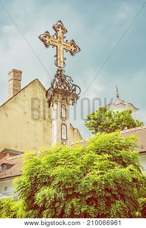 Detail of holy cross in Szentendre Hungary. Religious architecture. Place of worship. Symbolic object. Yellow photo filter.