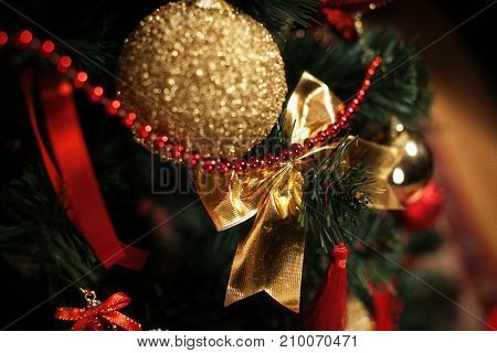 Christmas tree with a golden ball and bow