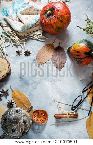 Autumn background with yellow maple leaves and pumpkins. Frame of fall harvest with copy space. Mockup for seasonal offers and holiday post card top view