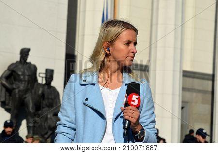 Pro-presidential CHANNEL5 TV field reporter. Protests against president Poroshenko. Kiev,Ukraine.October 18, 2017