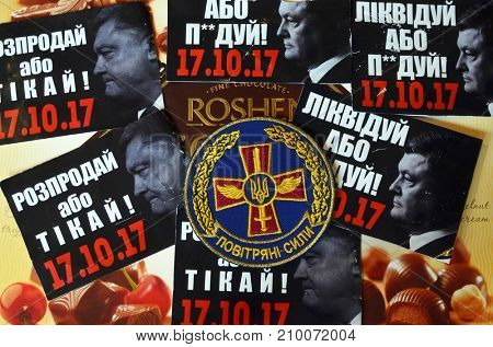 ILLUSTRATIVE EDITORIAL. Chevron of Ukrainian Air Force.Sticker  Pork -go away (UKR).Protests againstr president Poroshenko. Trademark Roshen is property of president.Kiev,Ukraine.October 18, 2017