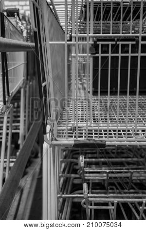 Many shopping carts of a supermarket black and white