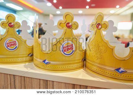 SAINT PETERSBURG - CIRCA OCTOBER, 2017: paper crowns at Burger King restaurant. Burger King is an American global chain of hamburger fast food restaurants.