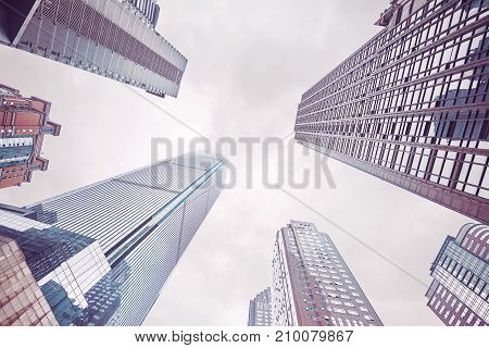 Looking Up At Skyscrapers In Clouds, Chongqing, China.