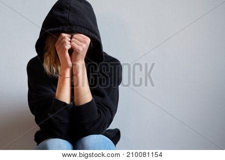 Sad Teenager Girl With Black Sweatshirt Hooded Isolated