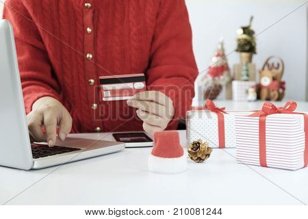Woman Holding Credit Card And Doing Shopping Online.