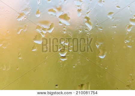 water droplets on glass as background . Photo of an abstract texture