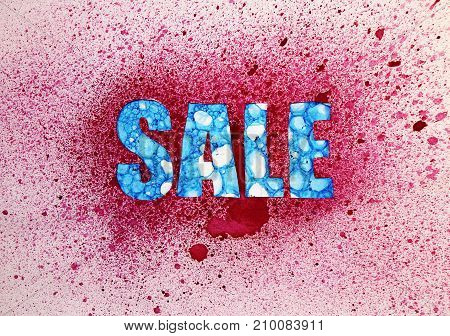 Sale of text with a blue pattern and a red background from splashes and drops of watercolor paint