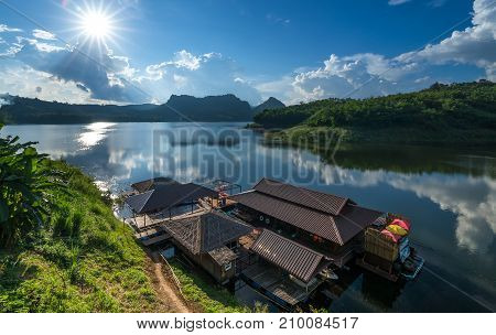 Beautiful views of wooden house floating on river in Mae Suai Dam Chiang Rai Province Thailand.