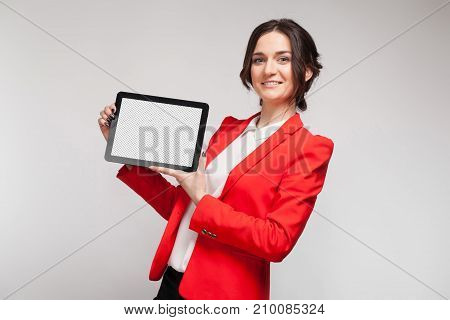 Picture Of Beautiful Woman In Red Blazer Standing With Tablet In Hands